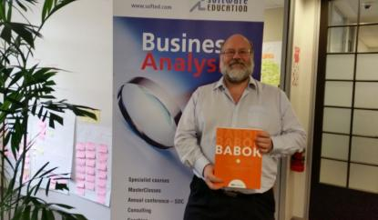 Photo of Shane Hastie holding the BABOK book